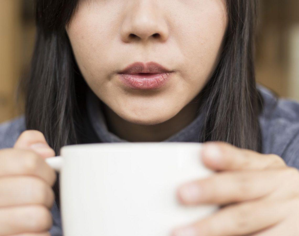 hot-coffee-tea-blowing-cool-woman-champja-iStock_94231329_MEDIUM (1)